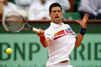 PARIS, FRANCE - JUNE 03:  Novak Djokovic of Serbia hits a forehand during the men's singles semi final match between Roger Federer of Switzerland and Novak Djokovic of Serbia on day thirteen of the French Open at Roland Garros on June 3, 2011 in Paris, Fr