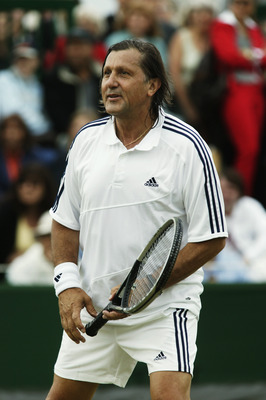 LONDON - JULY 1:  Ilie Nastase of Romania in action during the Gentlemen's over 45 Doubles match at the Wimbledon Lawn Tennis Championships held on July 1, 2003 at the All England Lawn Tennis and Croquet Club, in Wimbledon, London. (Photo by Alex Livesey/