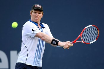 LOS ANGELES, CA - JULY 29:  Jim Courier returns a shot to Stefan Edberg during the Legends match at the LA Tennis Open Day Three at Los Angeles Tennis Center - UCLA on July 29, 2009 in Los Angeles, California.  Courier defeated Edberg 4-6, 6-4, 11-9.  (Ph
