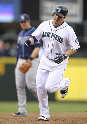 SEATTLE - JUNE 02:  Jack Cust #29 of the Seattle Mariners rounds the bases after hitting a homerun against the Tampa Bay Rays at Safeco Field on June 2, 2011 in Seattle, Washington. (Photo by Otto Greule Jr/Getty Images)