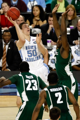 DETROIT - APRIL 06:  Tyler Hansbrough #50 of the North Carolina Tar Heels shoots the ball over Marquise Gray #41 of the Michigan State Spartans in the first half during the 2009 NCAA Division I Men's Basketball National Championship game at Ford Field on