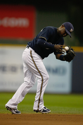 MILWAUKEE, WI - JUNE 9: Yuniesky Betancourt #3 of the Milwaukee Brewers fields the baseball against the New York Mets at Miller Park on June 9, 2011 in Milwaukee, Wisconsin. The Mets defeated the Brewers 4-1. (Photo by Scott Boehm/Getty Images)