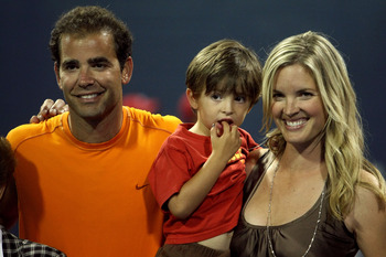 LOS ANGELES, CA - JULY 27:  Tournament honoree Pete Sampras poses for a portrait with son Ryan and wife Bridgette Wilson during the LA Tennis Open Day 1 at Los Angeles Tennis Center - UCLA on July 27, 2009 in Los Angeles, California.  (Photo by Stephen Du