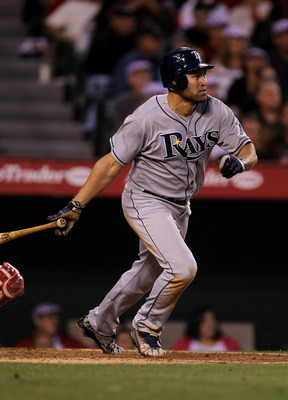 ANAHEIM, CA - JUNE 7:  Johnny Damon #22 of the Tampa Bay Rays hits an RBI double in the fourth inning against the Los Angeles Angels of Anaheim on June 7, 2011 at Angel Stadium in Anaheim, California.  (Photo by Stephen Dunn/Getty Images)