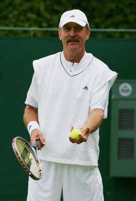 LONDON - JULY 05:  Stan Smith of USA looks on during the Senior Gentleman's Invitational Doubles match against Jeremy Bates of Great Britain and Anders Jarryd of Sweden during day ten of the Wimbledon Lawn Tennis Championships at the All England Lawn Tenn
