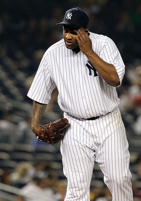 NEW YORK, NY - JUNE 09:  CC Sabathia #52 of the New York Yankees wipes sweat from his face in the seventh inning against the Boston Red Sox on June 9, 2011 at Yankee Stadium in the Bronx borough of New York City.  (Photo by Nick Laham/Getty Images)