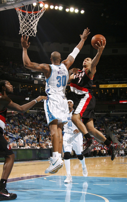 NEW ORLEANS - NOVEMBER 13:  Brandon Roy #7 of the Portland Trail lays up a shot against Blazers David West #30 of the New Orleans Hornets during the game at New Orleans Arena on November 13, 2009 in New Orleans, Louisiana.  NOTE TO USER: User expressly ac