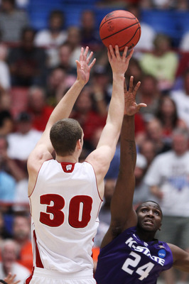 TUCSON, AZ - MARCH 19:  Jon Leuer #30 of the Wisconsin Badgers shoots over Curtis Kelly #24 of the Kansas State Wildcats in the first half during the third round of the 2011 NCAA men's basketball tournament at McKale Center on March 19, 2011 in Tucson, Ar