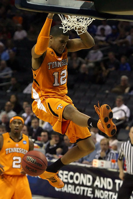 CHARLOTTE, NC - MARCH 18:  Tobias Harris #12 of the Tennessee Volunteers dunks the ball while taking on the Michigan Wolverines in the first half during the second round of the 2011 NCAA men's basketball tournament at Time Warner Cable Arena on March 18,