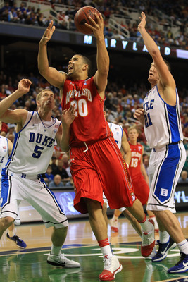 GREENSBORO, NC - MARCH 11:  Jordan Williams #20 of the Maryland Terrapins shoots against Mason Plumlee #5 and Miles Plumlee #21 of the Duke Blue Devils during the first half in the quarterfinals of the 2011 ACC men's basketball tournament at the Greensbor
