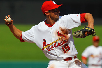 ST. LOUIS, MO - JUNE 4: Matt Carpenter #19 of the St. Louis Cardinals throws to first base against the Chicago Cubs in his major league debut at Busch Stadium on June 4, 2011 in St. Louis, Missouri.  The Cardinals beat the Cubs 5-4 in 12 innings.  (Photo