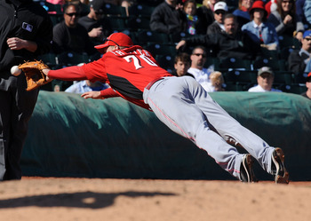 GOODYEAR, AZ - FEBRUARY 27:  Todd Frazier #70 of the Cincinnati Reds dives for a ground ball against the Cleveland Indians at Goodyear Ballpark on February 27, 2011 in Goodyear, Arizona.  (Photo by Norm Hall/Getty Images)