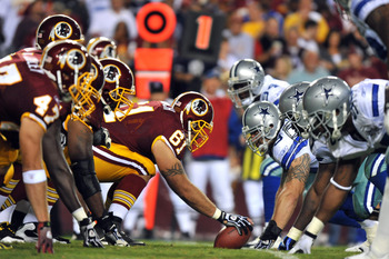 LANDOVER - SEPTEMBER 12:  Casey Rabach #61 of the Washington Redskins snaps the ball during the NFL season opener against the Dallas Cowboys at FedExField on September 12, 2010 in Landover, Maryland. The Redskins defeated the Cowboys 13-7. (Photo by Larry