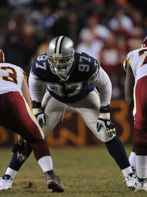 LANDOVER, MD - DECEMBER 27:  Jason Hatcher #97 of the Dallas Cowboys defends against the Washington Redskins at FedExField on December 27, 2009 in Landover, Maryland. The Cowboys defeated the Redskins 17-0. (Photo by Larry French/Getty Images)