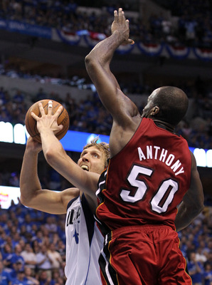 DALLAS, TX - JUNE 07:  Dirk Nowitzki #41 of the Dallas Mavericks drives against Joel Anthony #50 of the Miami Heat in Game Four of the 2011 NBA Finals at American Airlines Center on June 7, 2011 in Dallas, Texas. NOTE TO USER: User expressly acknowledges