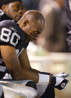 OAKLAND, CA - DECEMBER 22:  Jerry Rice #80 of the Oakland Raiders sits on the bench against the Green Bay Packers during an NFL game on December 22, 2003  at the Network Associates Coliseum in Oakland, California.  (Photo by Jed Jacobsohn/Getty Images)