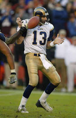 LANDOVER, MD - NOVEMBER 24:  Quarterback Kurt Warner #13 of the St. Louis Rams fumbles the ball after being hit by LaVar Arrington of the Washington Redskins as time ran out in the 4th quarter on November 24, 2002 at FedEx Field in Landover, Maryland.  Th