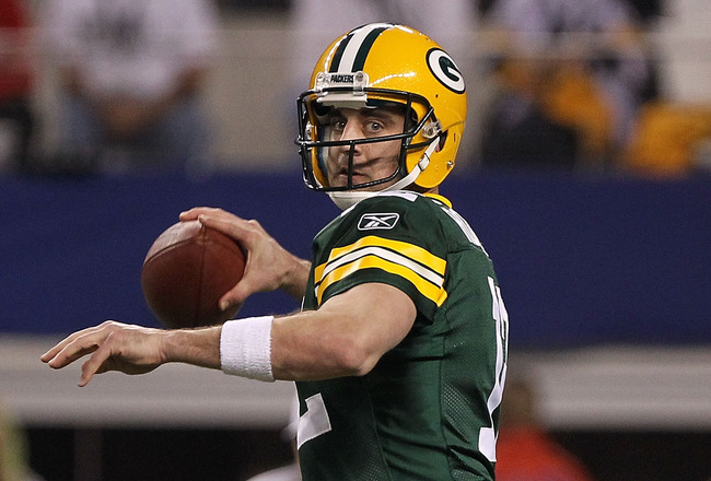 ARLINGTON, TX - FEBRUARY 06:  Quarterback Aaron Rodgers #12 of the Green Bay Packers throws the ball against the Pittsburgh Steelers during Super Bowl XLV at Cowboys Stadium on February 6, 2011 in Arlington, Texas.  (Photo by Doug Pensinger/Getty Images)