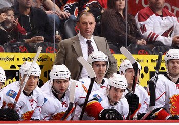 GLENDALE, AZ - MARCH 10:  Head coach Brent Sutter of the Calgary Flames watches from the bench during the NHL game against the Phoenix Coyotes at Jobing.com Arena on March 10, 2011 in Glendale, Arizona.  The Coyotes defeated the Flames 3-0.  (Photo by Chr