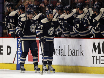 CHICAGO, IL - FEBRUARY 18: Derek ManKenzie #24 and Matt Calvert #11 of the Columbus Blue Jackets celebrate MacKenzie's 2nd period goal against the Chicago Blackhawks with teammates on the bench at the United Center on February 18, 2011 in Chicago, Illinoi