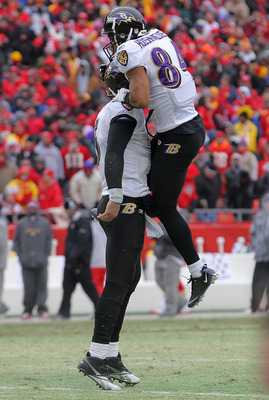 KANSAS CITY, MO - JANUARY 09:  Quarterback Joe Flacco #5 of the Baltimore Ravens celebrates a touchdown with wide receiver T.J. Houshmandzadeh #84 against the Kansas City Chiefs in the second quarter of their 2011 AFC wild card playoff game at Arrowhead S