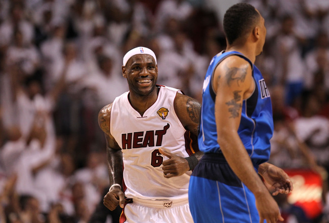 MIAMI, FL - JUNE 02:  LeBron James #6 of the Miami Heat reacts as he runs by Shawn Marion #0 of the Dallas Mavericks in the first half of Game Two of the 2011 NBA Finals at American Airlines Arena on June 2, 2011 in Miami, Florida. NOTE TO USER: User expr