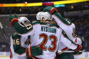 ST. LOUIS, MO - MARCH 29: Eric Nystrom #23 of the Minnesota Wild is congratulated by teammates after scoring a goal against the St. Louis Blues at the Scottrade Center on March 29, 2011 in St. Louis, Missouri.  (Photo by Dilip Vishwanat/Getty Images)