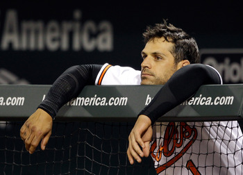 BALTIMORE, MD - APRIL 28: Brian Roberts #1 of the Baltimore Orioles looks on from the dugout during the eighth inning of their 6-2 loss to the Boston Red Sox at Oriole Park at Camden Yards on April 28, 2011 in Baltimore, Maryland.  (Photo by Rob Carr/Gett