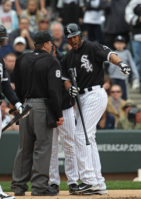 CHICAGO, IL - MAY 01: Alex Rios #51 of the Chicago White Sox argues with home plate umpire Cory Blaser #89 after being called out on stikes in the 9th inning against the Baltimore Orioles at U.S. Cellular Field on May 1, 2011 in Chicago, Illinois. The Ori