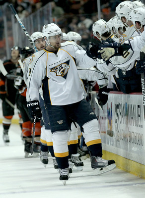ANAHEIM - APRIL 22:  Kevin Klein #8 of the Nashville Predators celebrates with teammates after his first period goal against the Anaheim Ducks in Game Five of the Western Conference Quarterfinals during the 2011 NHL Stanley Cup Playoffs at Honda Center on