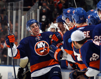 UNIONDALE, NY - APRIL 08: Travis Hamonic #36 of the New York Islanders celebrates his third period game tying goal against the Pittsburgh Penguins at the Nassau Coliseum on April 8, 2011 in Uniondale, New York. The Penguins defeated the Islanders 4-3 in t