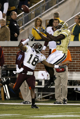 ATLANTA - NOVEMBER 1: Wide receiver James Johnson #89 of the Georgia Tech Yellow Jackets goes up for a first quarter reception over cornerback Brandon Flowers #18 of the Virginia Tech Hokies November 1, 2007 at Bobby Dodd Stadium at Historic Grant Field i