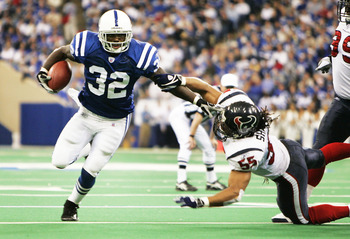 INDIANAPOLIS - NOVEMBER 14:  Running back Edgerrin James #32 of the Indianapolis Colts stiff arms linebacker Jamie Sharper #55 of the Houston Texans to pick up 28 yards before getting pushed out of bounds at the one yard line in the second quarter on Nove