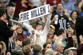 DETROIT - DECEMBER 4:  A young fan holds up a sign to fire Matt Millen, President and CEO of the Detroit Lions, during the game between the Lions and Minnesota Vikings at Ford Field on December 4, 2005 in Detroit, Michigan. The Vikings won the game 21-16.