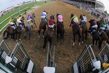 BALTIMORE, MD - MAY 21:  The field breaks from the gate during the 136th running of the Preakness Stakes at Pimlico Race Course on May 21, 2011 in Baltimore, Maryland.  (Photo by Rob Carr/Getty Images)