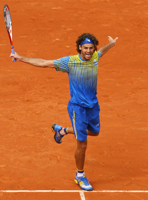 PARIS - MAY 25:  Gustavo Kuerten of Brazil celebrates a point during the Men's Singles first round match against Paul-Henri Mathieu of France on day one of the French Open at Roland Garros on May 25, 2008 in Paris, France. The French Open with be Kuertens