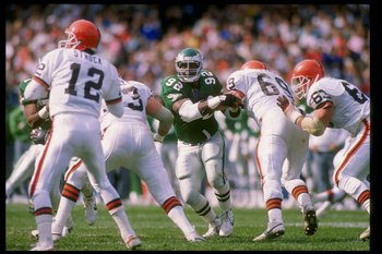16 Oct 1988:  Defensive tackle Reggie White of the Philadelphia Eagles (center) runs toward quarterback Don Strock of the Cleveland Browns (left) during a game at Cleveland Stadium in Cleveland, Ohio.  The Browns won the game 19-3. Mandatory Credit: Rick