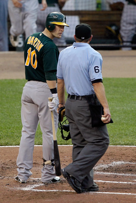 BALTIMORE, MD - JUNE 08: Daric Barton #10 of the Oakland Athletics has words with umpire Chris Guccione after striking out to end the third inning against the Baltimore Orioles at Oriole Park at Camden Yards on June 8, 2011 in Baltimore, Maryland. The Bal