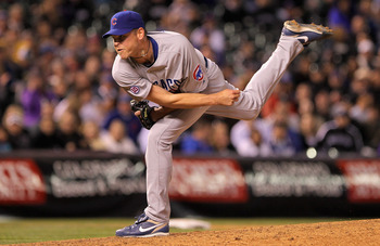 DENVER, CO - APRIL 16:  Relief pitcher Kerry Wood #34 of the Chicago Cubs works against Jason Giambi #23 of the Colorado Rockies in the eighth inning at Coors Field on April 16, 2011 in Denver, Colorado.  (Photo by Doug Pensinger/Getty Images)