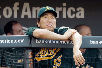 BALTIMORE, MD - JUNE 08: Hideki Matsui #55 of the Oakland Athletics looks on from the dugout during the second inning against the Baltimore Orioles  at Oriole Park at Camden Yards on June 8, 2011 in Baltimore, Maryland.  (Photo by Rob Carr/Getty Images)