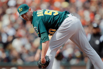 SAN FRANCISCO, CA - MAY 22:  Grant Balfour #50 of the Oakland A's looks to first base before throwing a pitch against the San Francisco Giants at AT&amp;T Park on May 22, 2011 in San Francisco, California.  The Giants won 5-4.  (Photo by Brian Bahr/Getty Imag