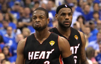 DALLAS, TX - JUNE 09:  Dwyane Wade #3 and LeBron James #6 of the Miami Heat look on in the fourth quarter against the Dallas Mavericks in Game Five of the 2011 NBA Finals at American Airlines Center on June 9, 2011 in Dallas, Texas.  NOTE TO USER: User ex