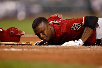 PITTSBURGH - JUNE 08:  Justin Upton #10 of the Arizona Diamondbacks lays on the ground at home plate after being hit by a pitch against the Pittsburgh Pirates during the game on June 8, 2011 at PNC Park in Pittsburgh, Pennsylvania.  (Photo by Jared Wicker