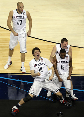 HOUSTON, TX - APRIL 04:  Kemba Walker #15, Benjamin Stewart #23, Tyler Olander #10 and Kyle Bailey #21 of the Connecticut Huskies react after defeating the Butler Bulldogs to win the National Championship Game of the 2011 NCAA Division I Men's Basketball