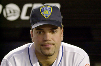 394801 04: Catcher Mike Piazza of the New York Mets wears a Port Authority Police hat in honor of the dead and missing emergency personnel before the Mets'' game against the Atlanta Braves at Shea Stadium in Flushing, NY September 21, 2001 in the first ma