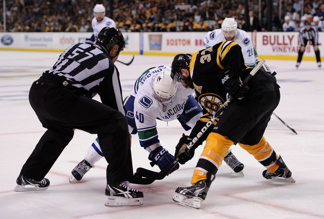 BOSTON, MA - JUNE 08:  Maxim Lapierre #40 of the Vancouver Canucks faces off agianst Patrice Bergeron #37 of the Boston Bruins during Game Four of the 2011 NHL Stanley Cup Final at TD Garden on June 8, 2011 in Boston, Massachusetts.  (Photo by Harry How/G