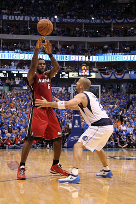 DALLAS, TX - JUNE 07: LeBron James #6 of the Miami Heat passes against Jason Kidd #2 of the Dallas Mavericks  in Game Four of the 2011 NBA Finals at American Airlines Center on June 7, 2011 in Dallas, Texas. The Mavericks won 86-83. NOTE TO USER: User exp