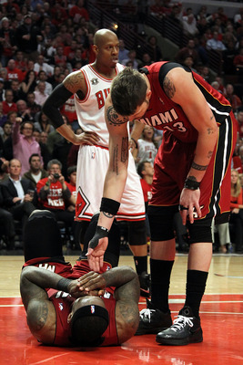 CHICAGO, IL - MAY 26:  Mike Miller #13 of the Miami Heat reaches down to help up teammate LeBron James after James was on the receiving end of a flagrant foul by Carlos Boozer #5 of the Chicago Bulls in the second half of Game Five of the Eastern Conferen