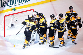BOSTON, MA - JUNE 08:  Tim Thomas #30 of the Boston Bruins celebrates with his teammates Patrice Bergeron #37, Dennis Seidenberg #44, David Krejci #46 and Daniel Paille #20 after defeating the Vancouver Canucks in Game Four of the 2011 NHL Stanley Cup Fin