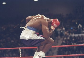 28 Jun 1997: Evander Holyfield jumps in the air and holds his head in agony after Mike Tyson bit a piece off his right ear in the third round of their heavyweight title fight at the MGM Grand Garden in Las Vegas, Nevada. Holyfield won the fight when refer
